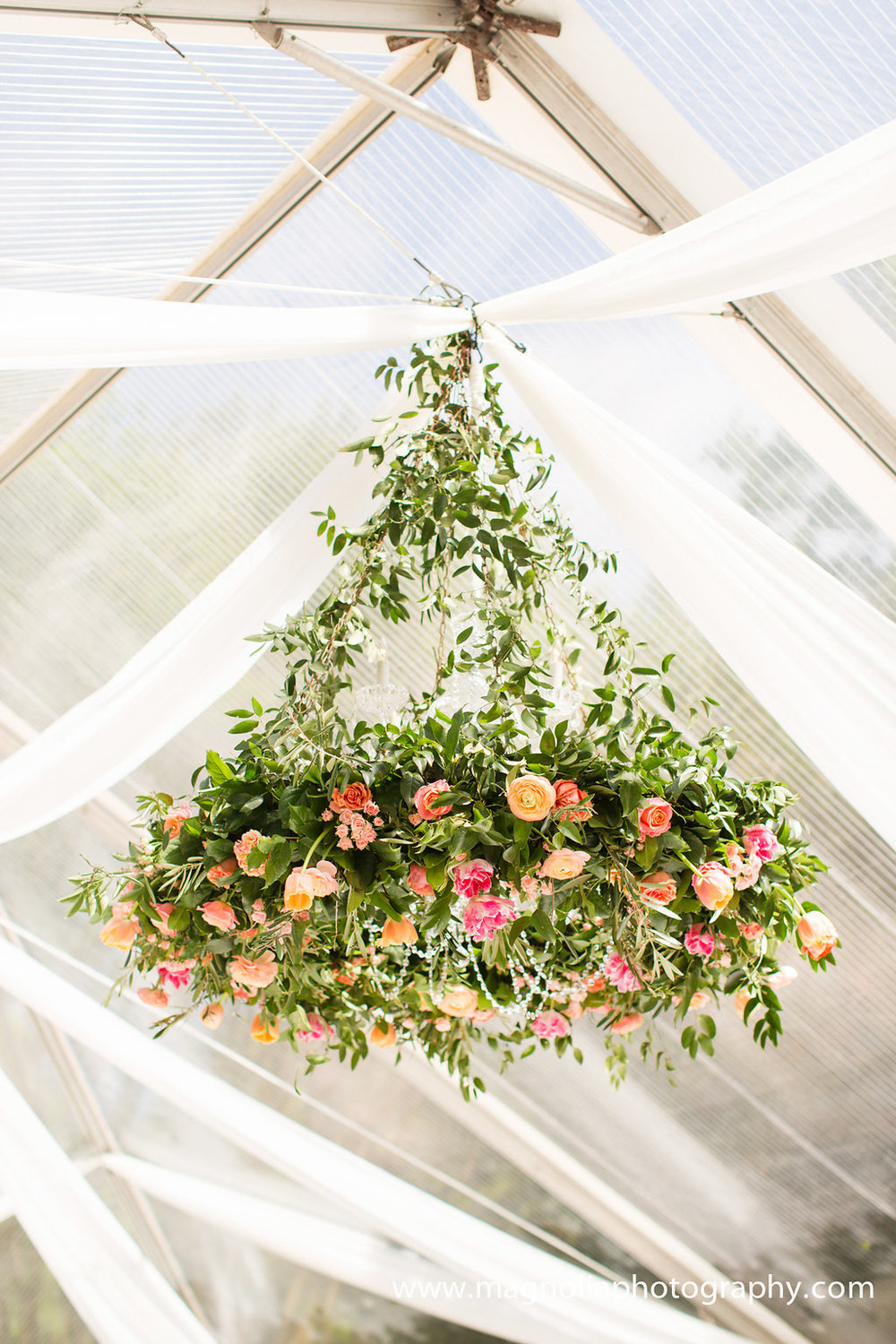 hanging-floral-chandelier-in-clear-tent