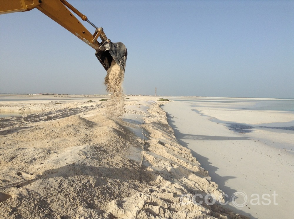 Covering geocontainers to create a wider, more protected beach
