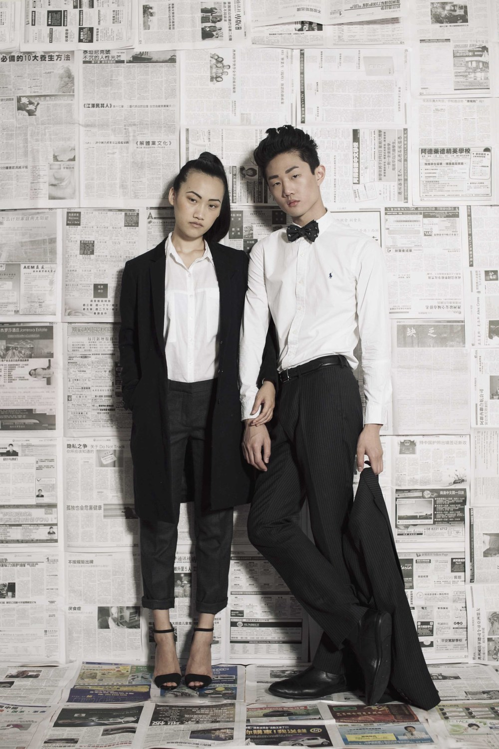 Jing wears: Jun Takahashi for Uniqlo coat, ASOS shirt, Miu Miu trousers, Zara shoes. Pierre wears: Ben Sherman suit, Polo Ralph Lauren shirt, Alexander McQueen bow tie, Armani Collezioni boots, Polo Ralph Lauren belt.