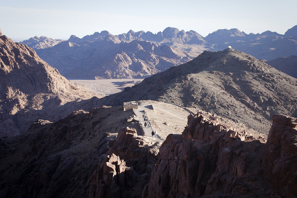 Trekkers descend Mt Sinai after hours and hours of hiking - or for the lazier amongst us, riding a camel.
