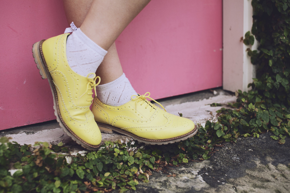 Neon yellow brogues