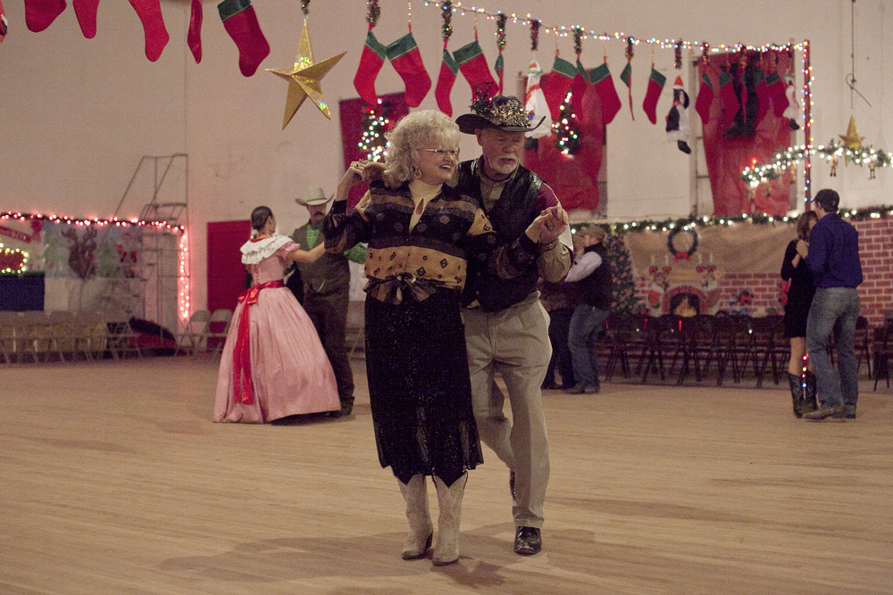 I imagine this is what American televangelists do in their spare time: country dancing in Oplin, Texas.