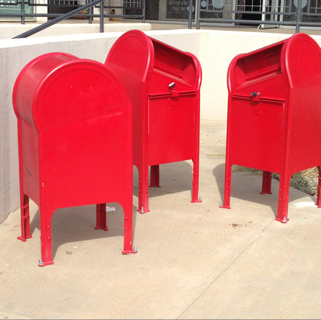 I found these three red mailboxes in front of a gallery. What a great prop to use for a senior photo session.