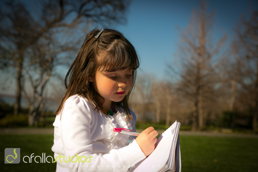Artist, Molly, drawing in her sketch pad.