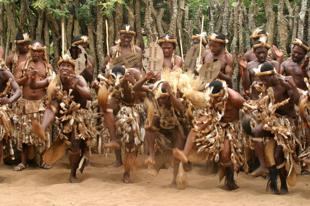 Figure 1:  An example of an African tribe performing a ceremonial dance.  These types of dances induce an ecstatic trance through rhythmic brainwave entrainment effected from repetitive vocals, percussion, and dance.