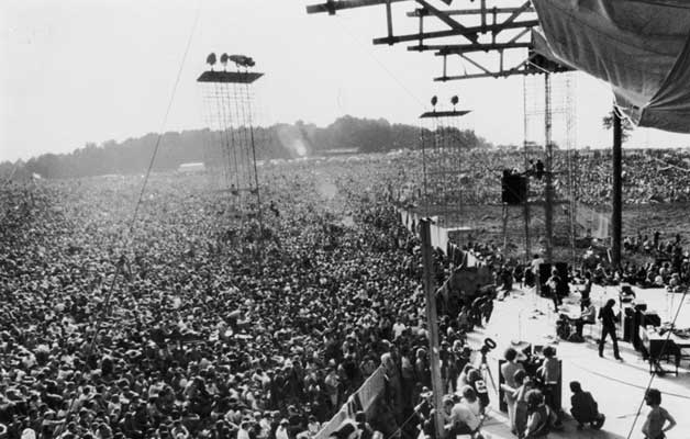"Figure 2:  Woodstock.  A festival in which a mass shared conscious experience swept through both the musicians and the audience.  This exchange of energy may have catalyzed ecstatic states of bliss and ecstasy within our reality, transcending the base level experience of the ""concert"" label."