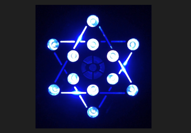 Figure 4:  The lamp face of a Pandora Star meditation light machine.  The machine facilitates the easiest way to slip into a meditate brainwave state through the principle of entrainment via flickering light.  The process is akin to how a vibrating tuning fork will impart its resonant vibrational frequency to another motionless tuning fork when both are brought within close proximity of one another.  The lamp head design is that of a Merkabah, and with the ability to see the additional lines of connectedness, a Metatron's Cube.