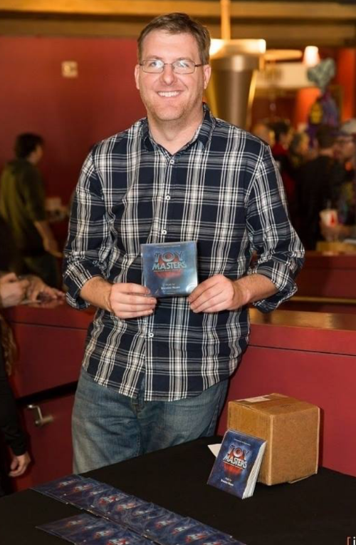 Brandon Moore with the Toy Masters Promo Soundtrack CDs at the the Toy Masters Booth