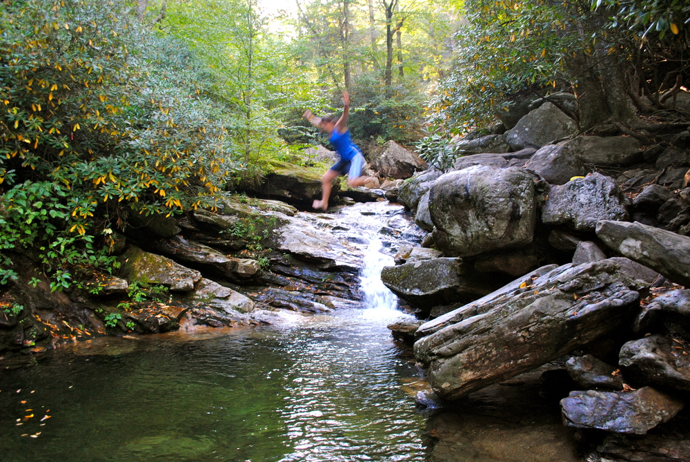 Sus jumping into Skinny Dip Falls off the Blue Ridge Parkway, NC