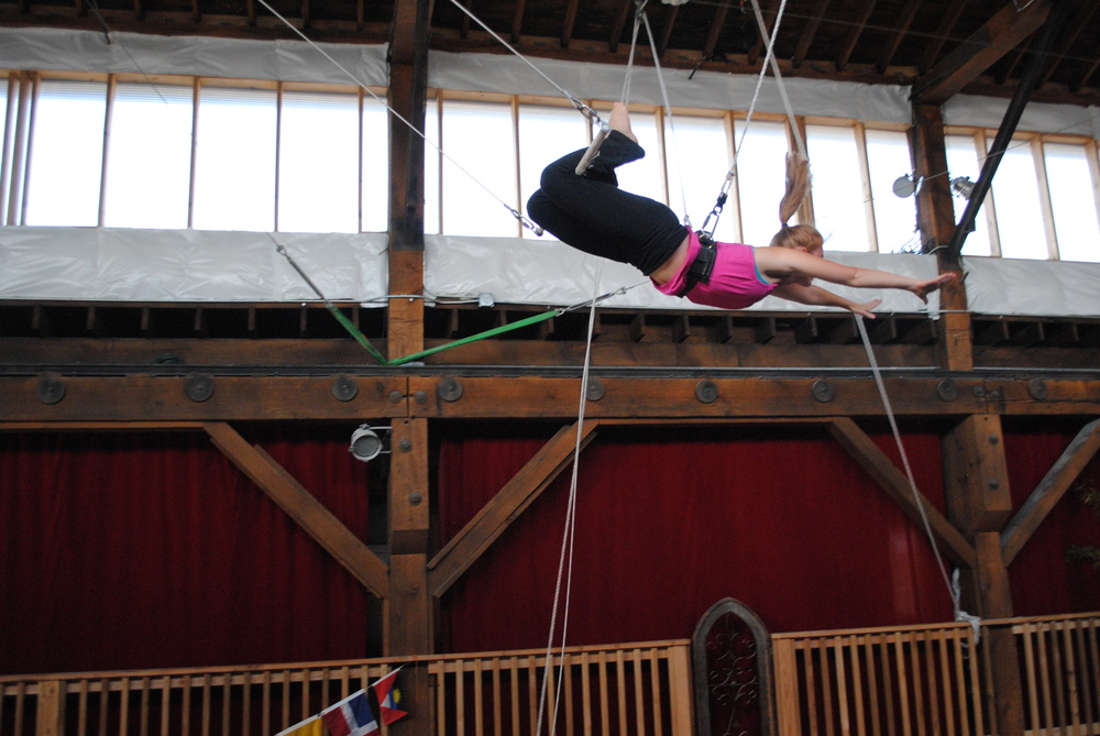 Chlo on the flying trapeze at Emerald City Trapeze Arts in Seattle, WA