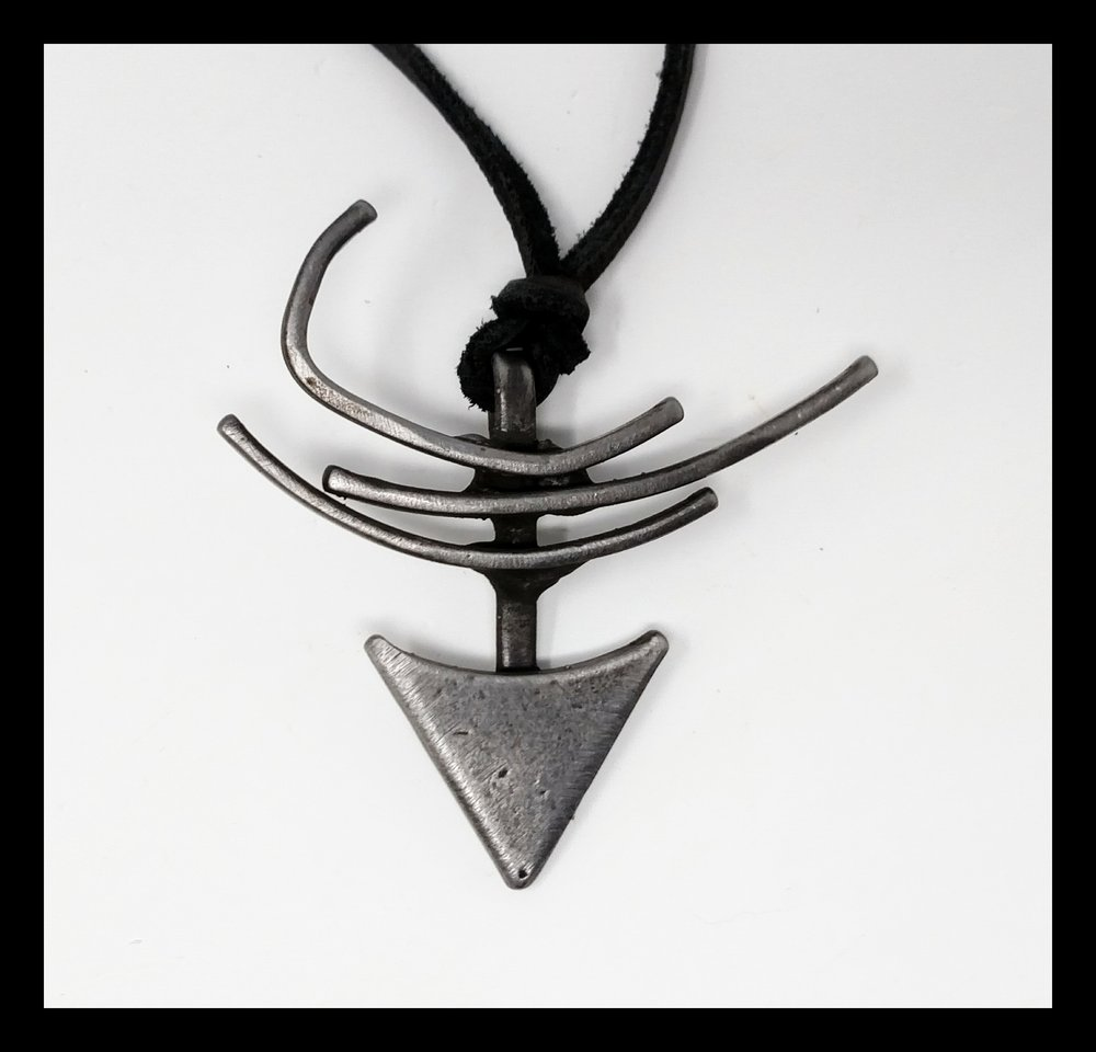 Something symbolic steel pendant.jpg