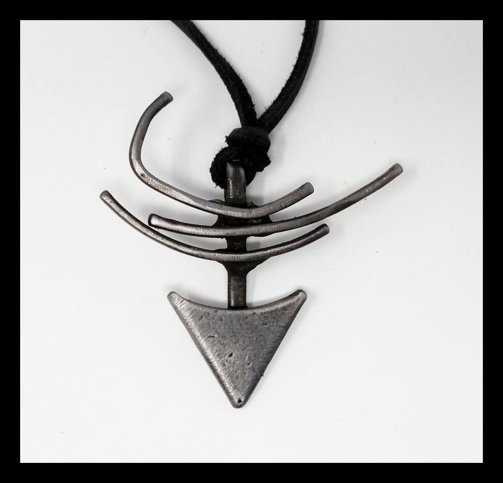 Something symbolic steel pendant.jpg