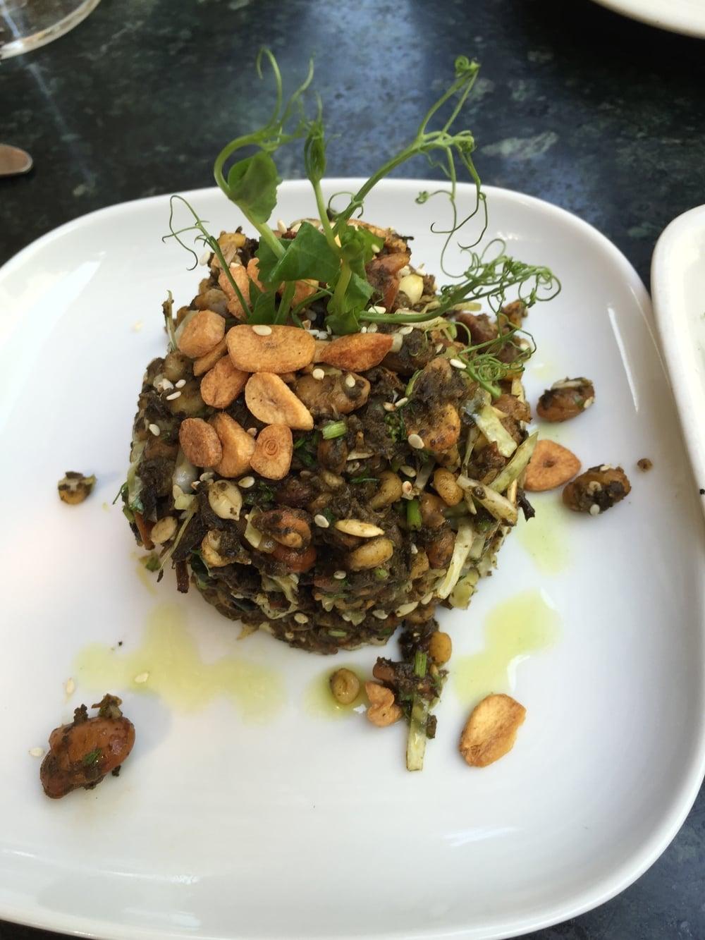 Pickled tea leaf salad with fried garlic