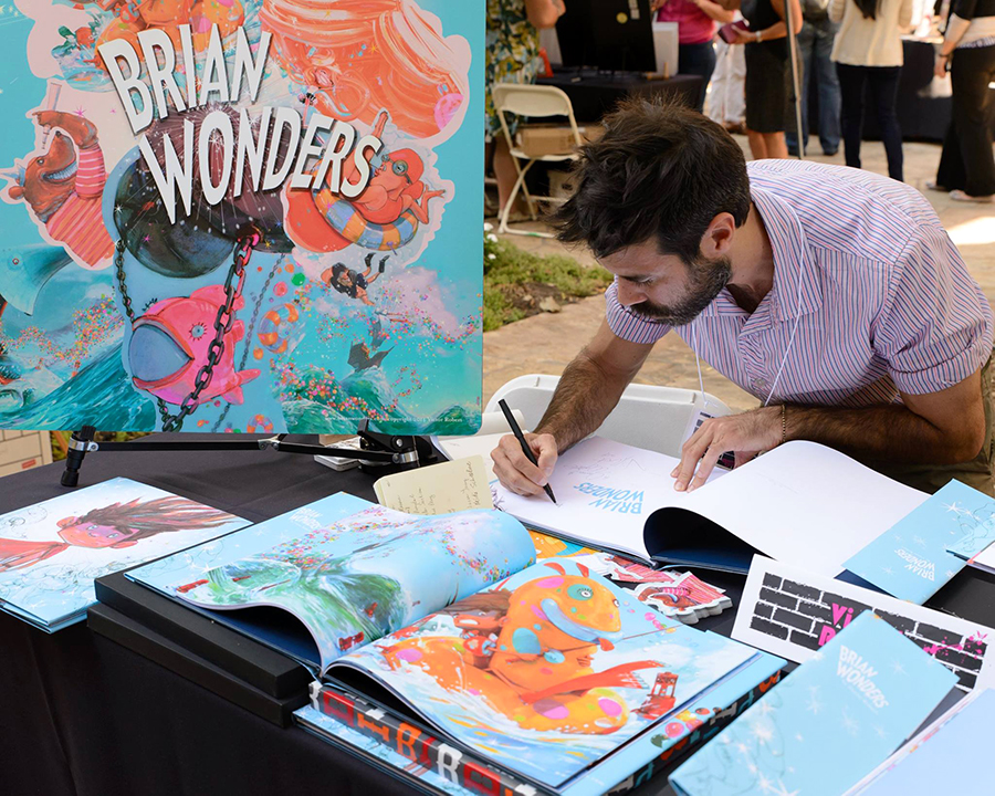 Victor Robert signing copies of his picture book, BRIAN WONDERS.  Photo by Michael Guttman Photography
