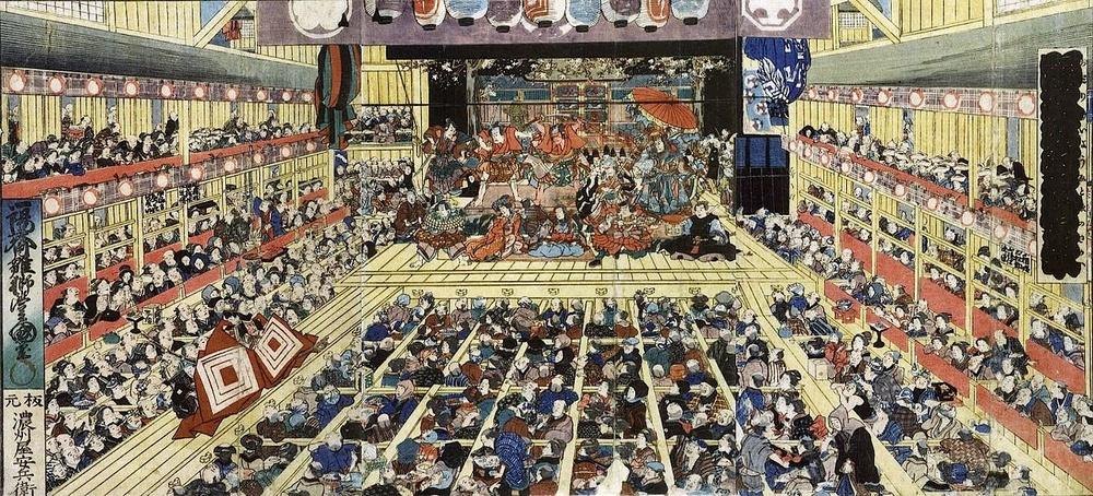 Så här kunde en kabukiteater se ut förr i världen, och det enda som egentligen hänt sedan detta tryck kom till är att besökarna numera oftast har västerländska kläder och att lokalen har elektriskt ljus.