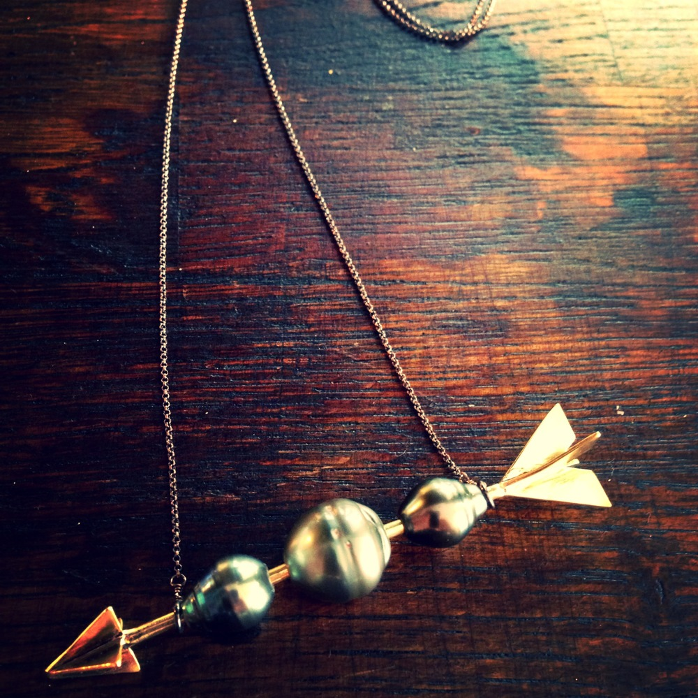 Anniversary Arrow necklace made with Tahitian pearls brought back from honeymoon.