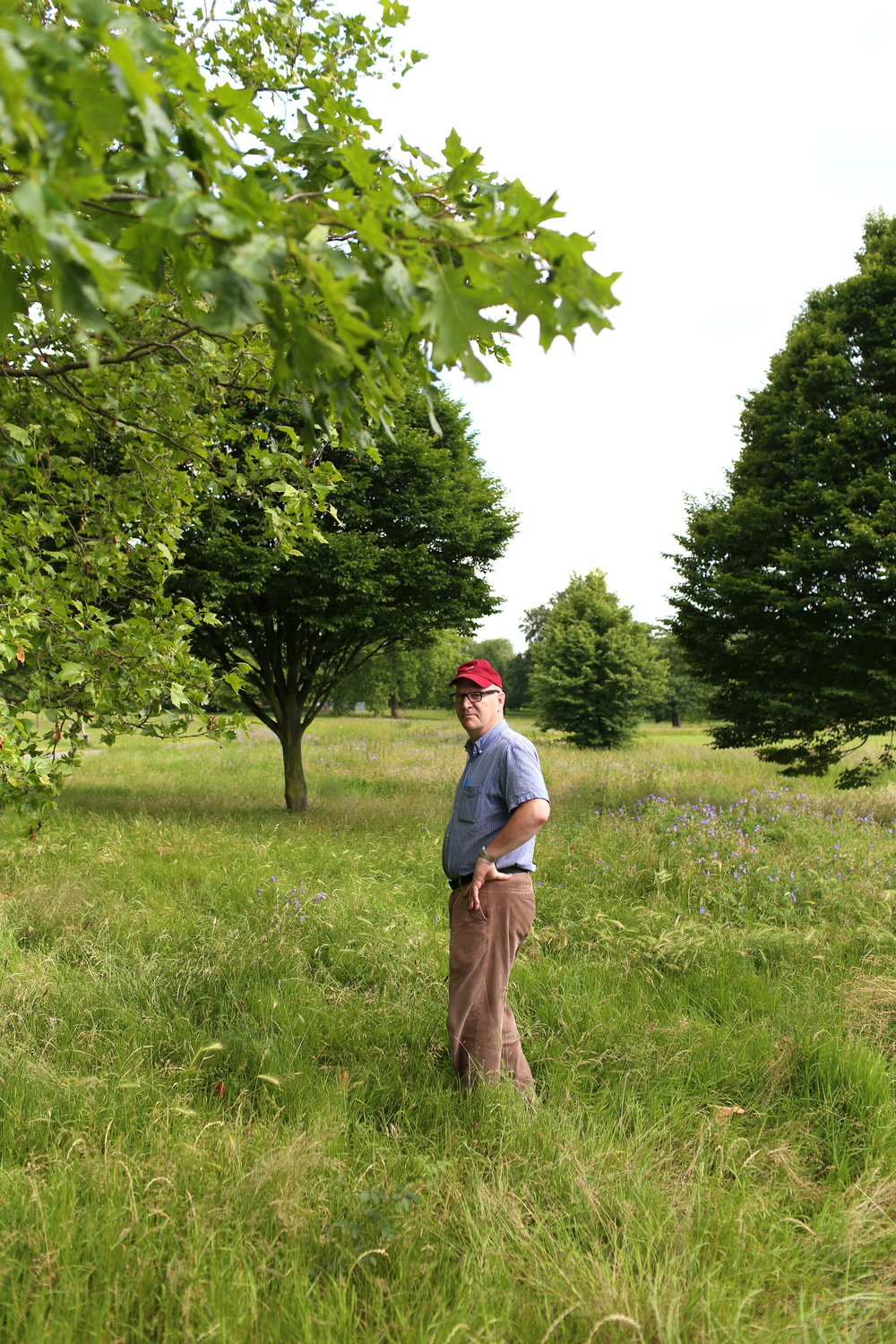 A man out standing in his field.