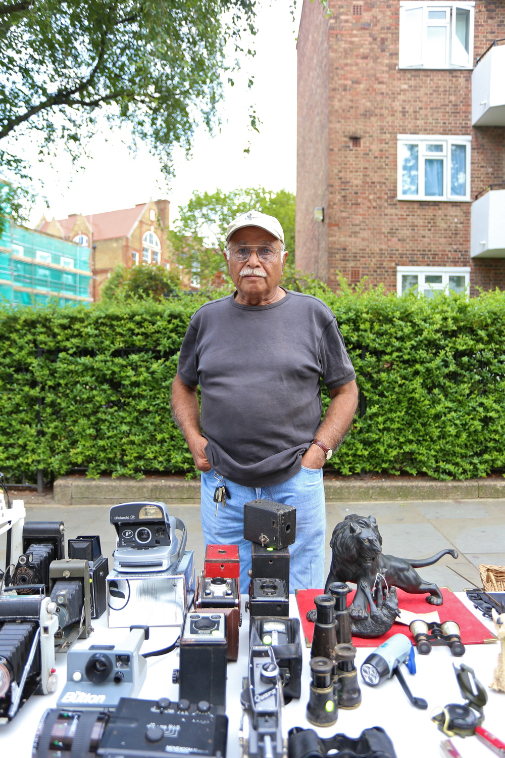 "This is Jafar, originally from Kirachi. He moved to London in 1957, and has been dealing in cameras for many years. I stopped to look at a Rolleiflex (which I ended up purchasing from him). We chatted for a bit, and I came to find out that he's been politically active through his activity in London, sharing his expertise with children back in Pakistan.  ""Youth must not be dragged on the road for the sake of politics."""