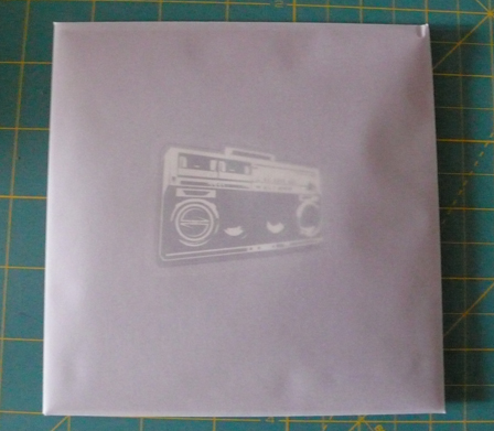 Gift wrap for a birthday CD. Vellum envelope with quad fold insert and sticker on the inside.