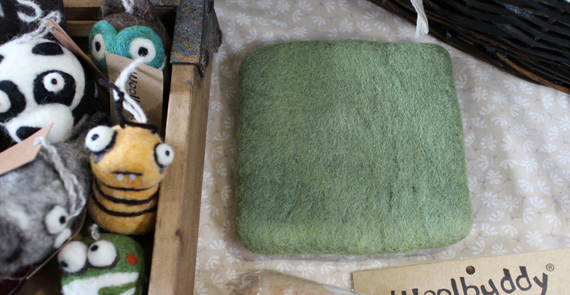 This square block of wool may not look cute but it's become one of my favorite tools for needle felting.