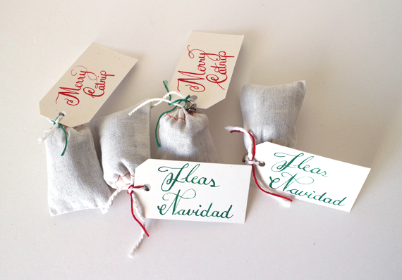 I created some  catnip toys  labeled Merry Catnip and Fleas Navidad.