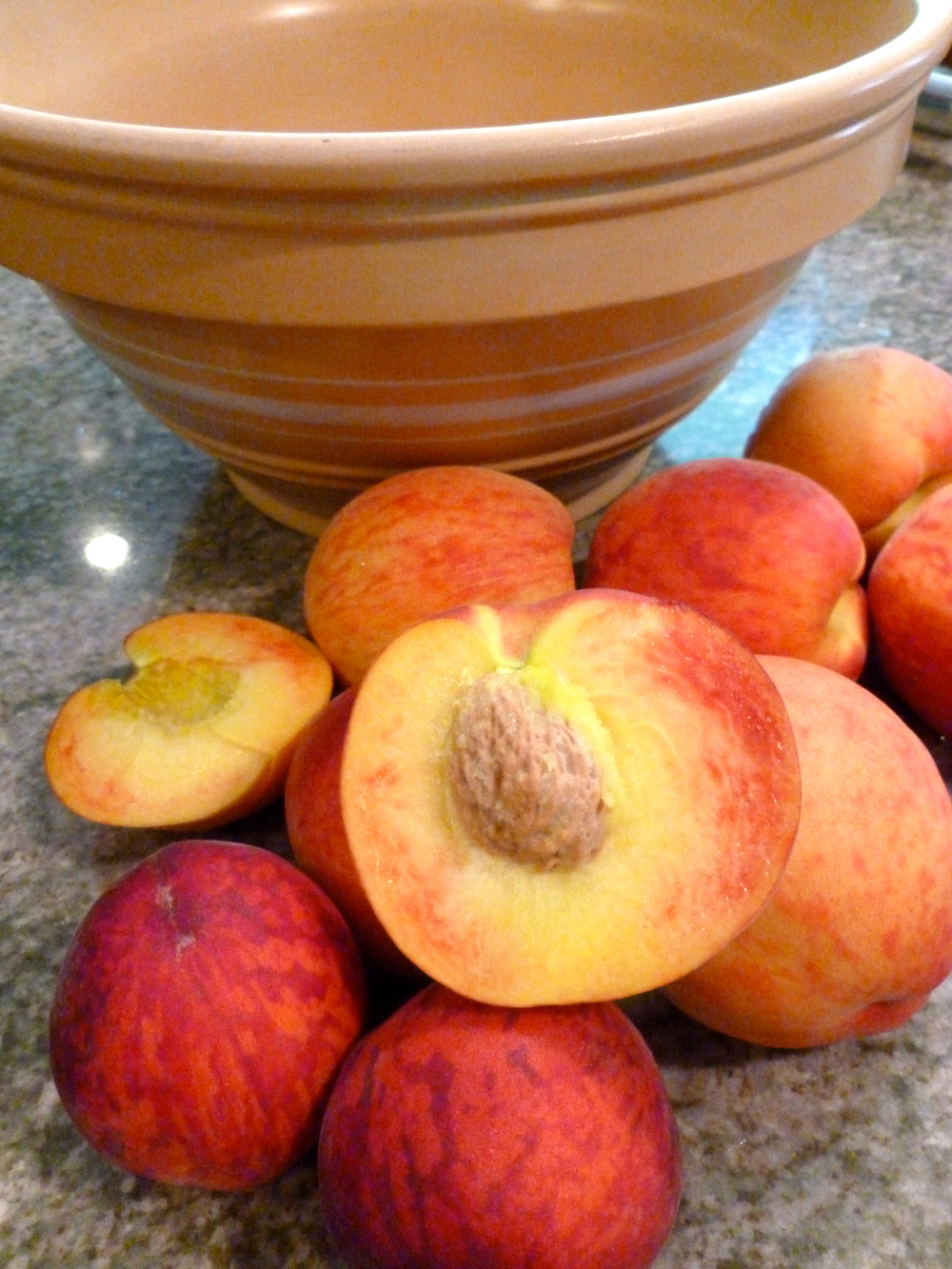 Freestone yellow peach ready for pie baking! See the pretty interior color!