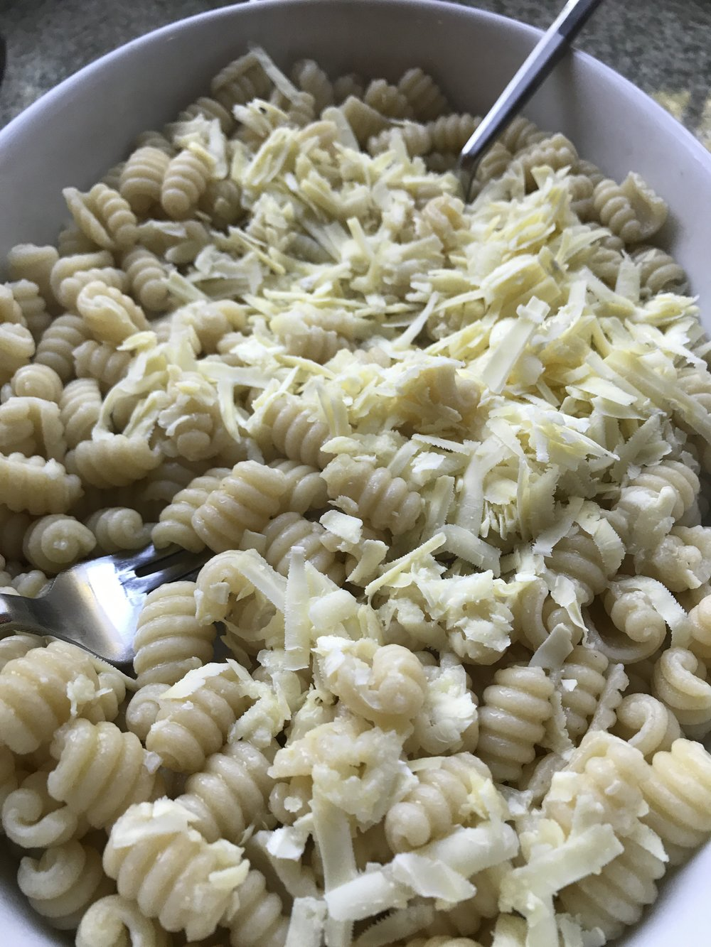 Toss the cheese with the pasta till it melts into the pasta.