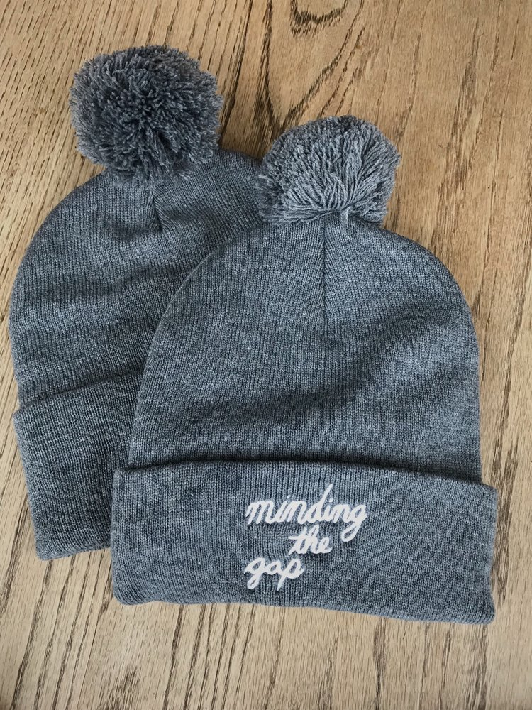 3239d60ea7085 Gray pom-pom Beanie — Minding the Gap