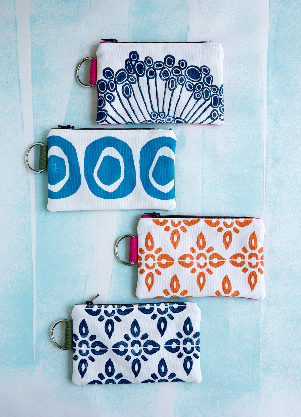 """I chose to focus on this technique because every printing session creates something unique."" Seen here - Zip Wallet designs."