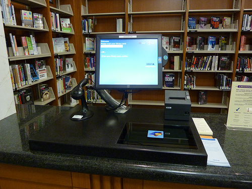 Just wave the book around... Or, you know, use the barcode scanner on the left.  photo bymemsphere