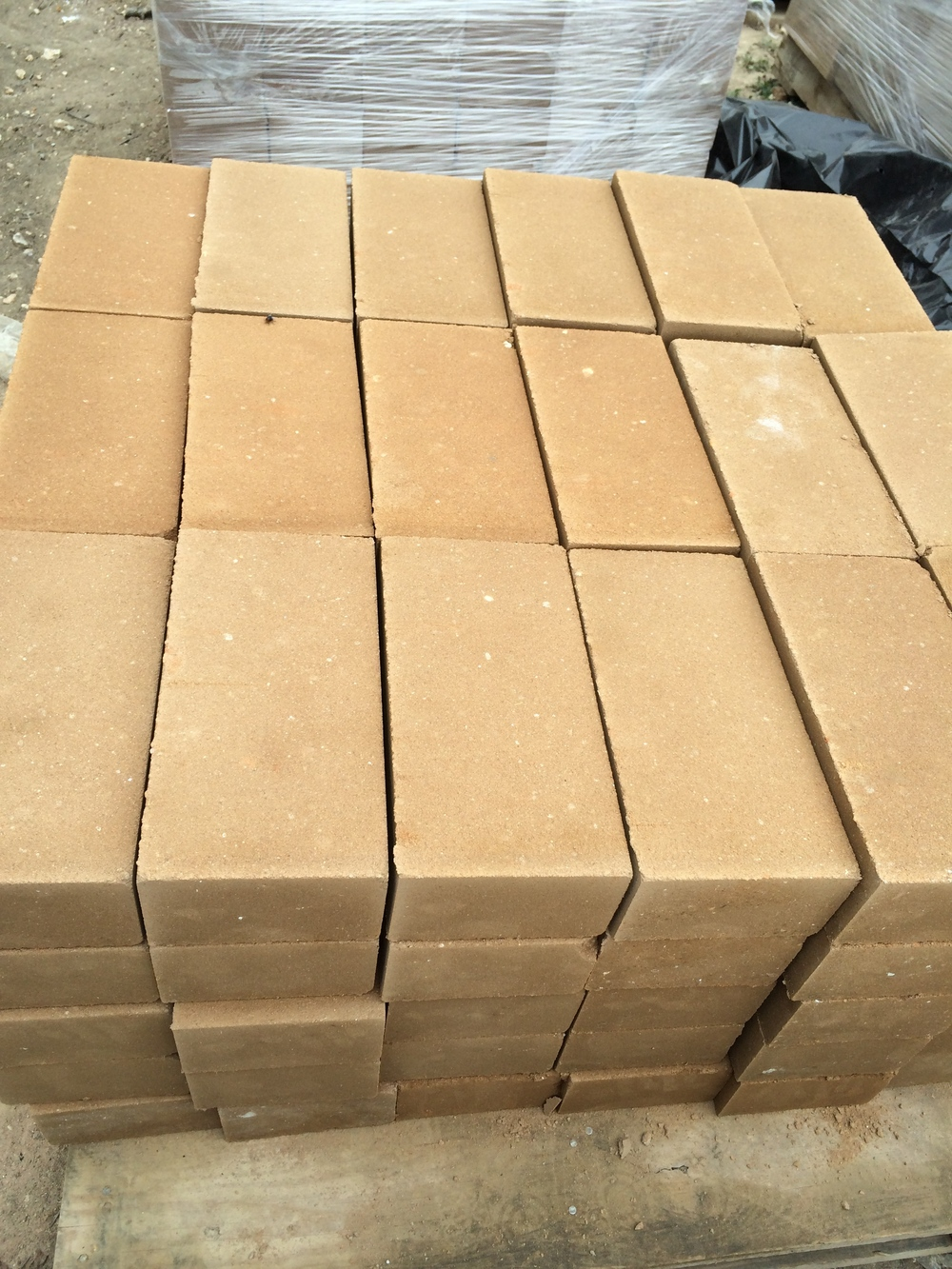 Freshly made blocks are placed on pallets for curing