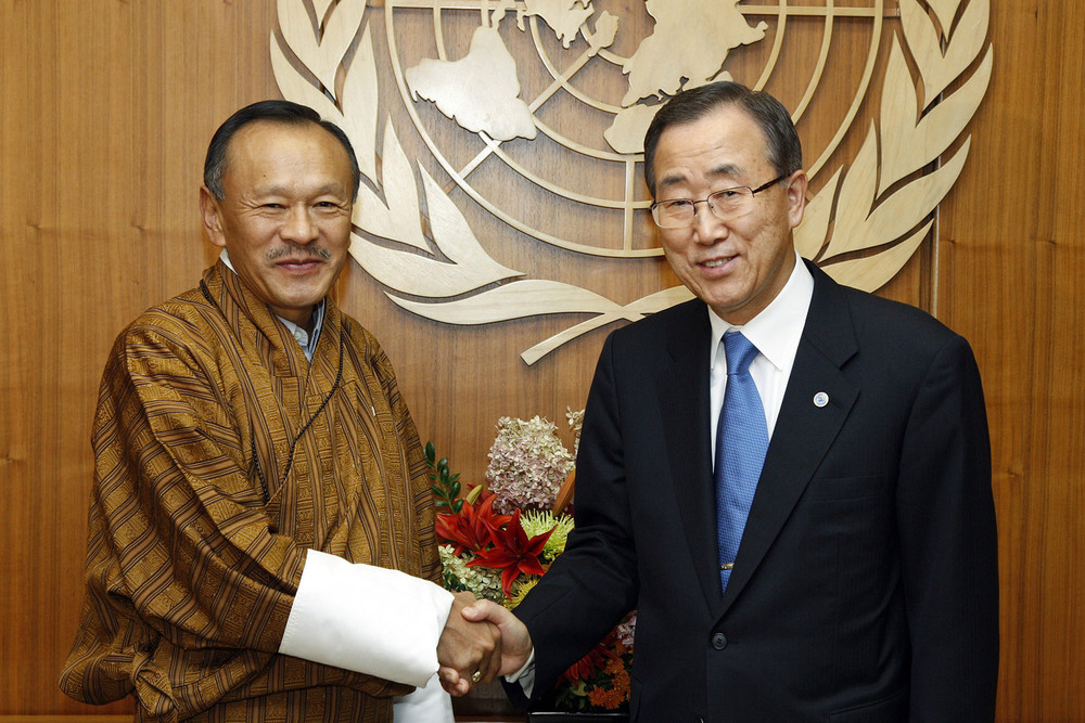 Prime Minister of Bhutan, Jigme Thinley, shakes hands with UN Secretary General Ban Ki-Moon after member states adopt new Happiness resolution.