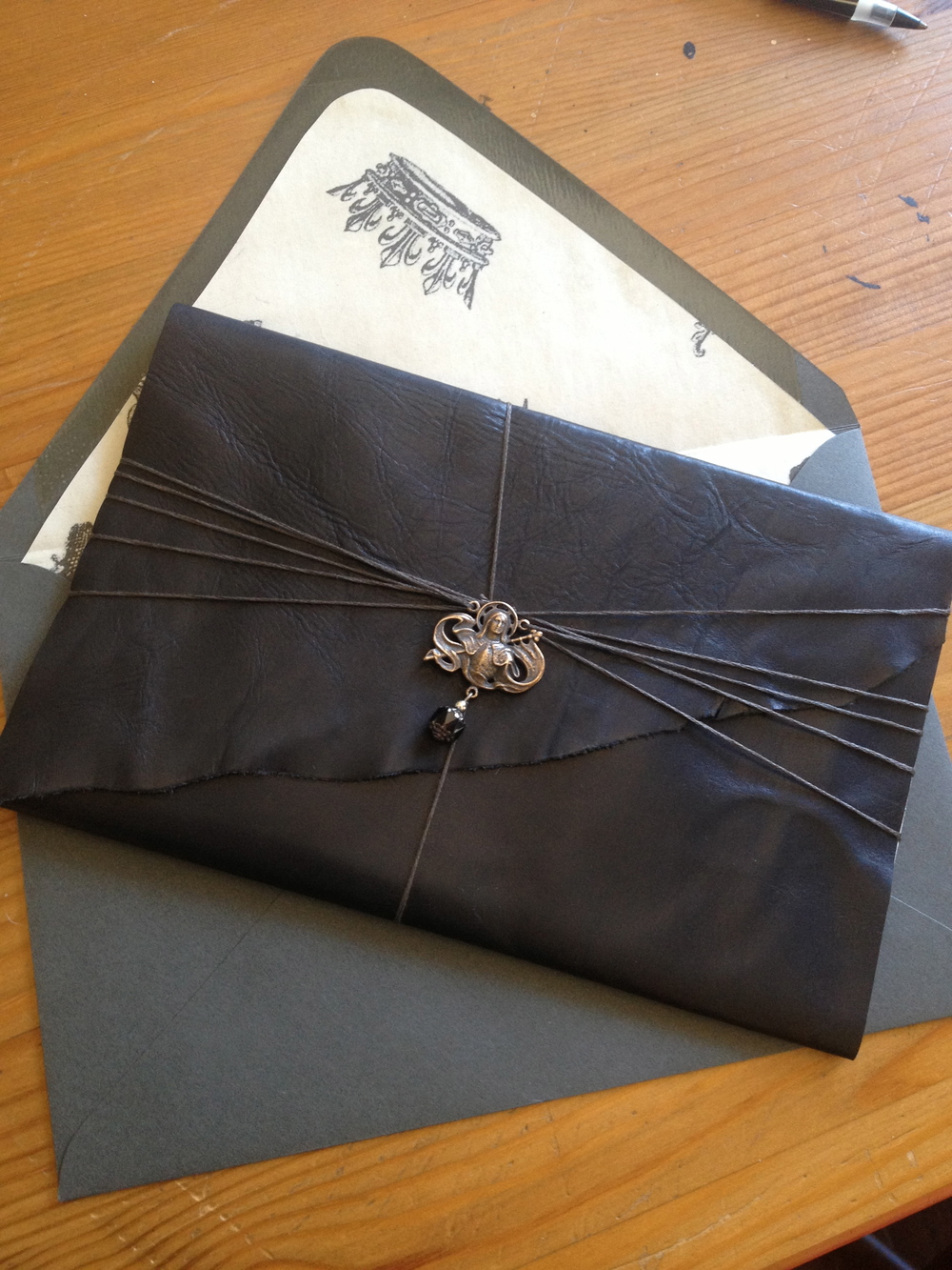 Leather wrapped invite
