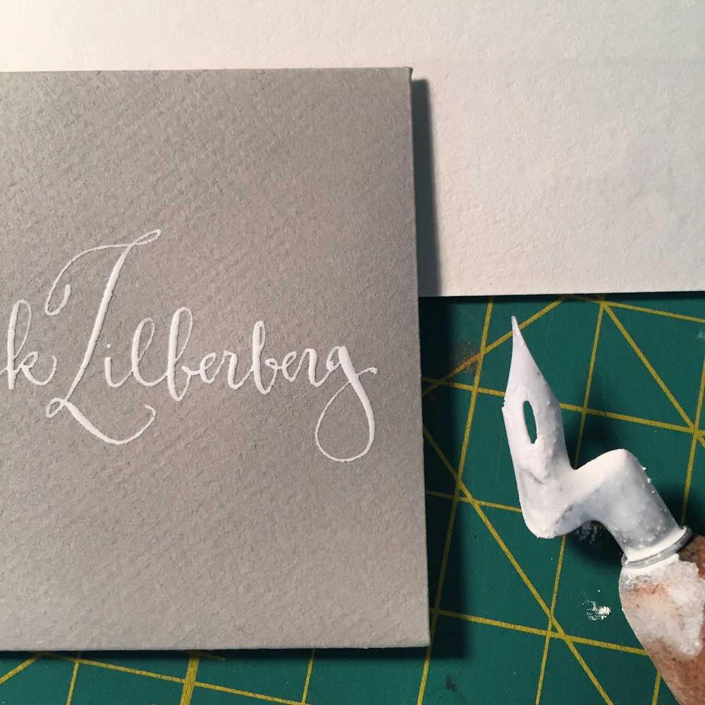 "White ink on ""Peace"" grey envelopes"
