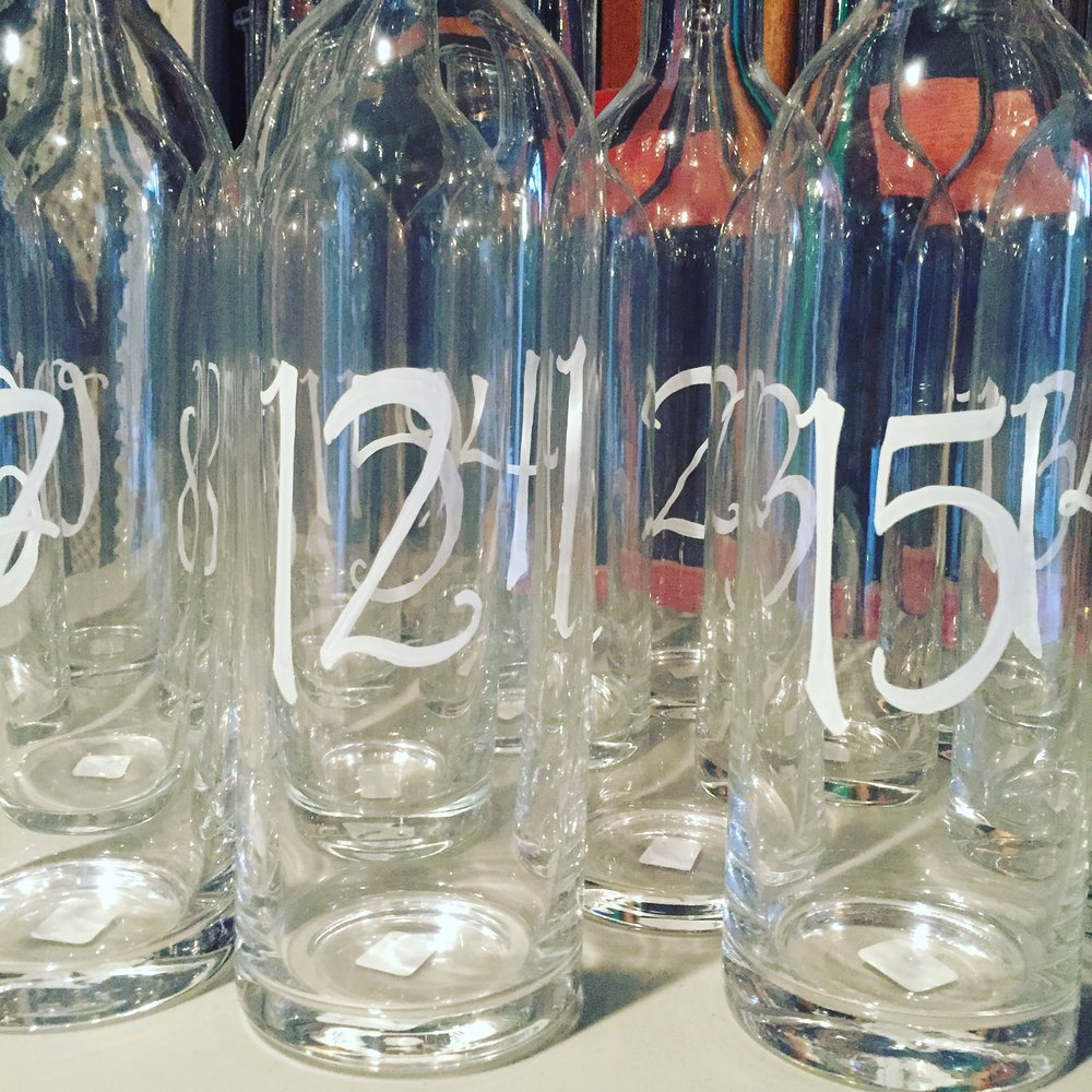 Table numbers on glass bottles