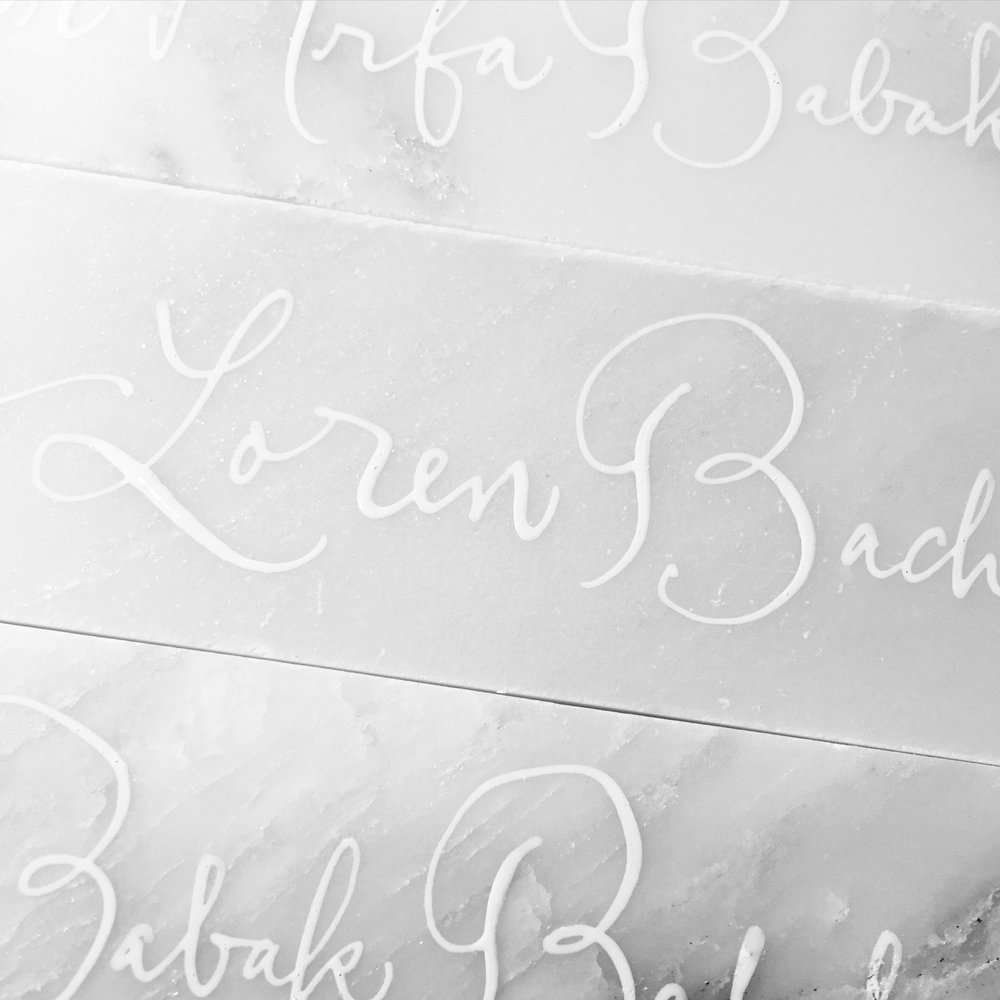Place cards, white ink on white marble