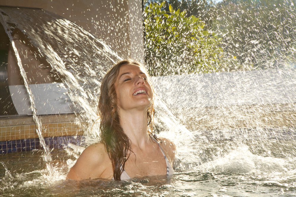 Woman under a spa waterfall.jpg