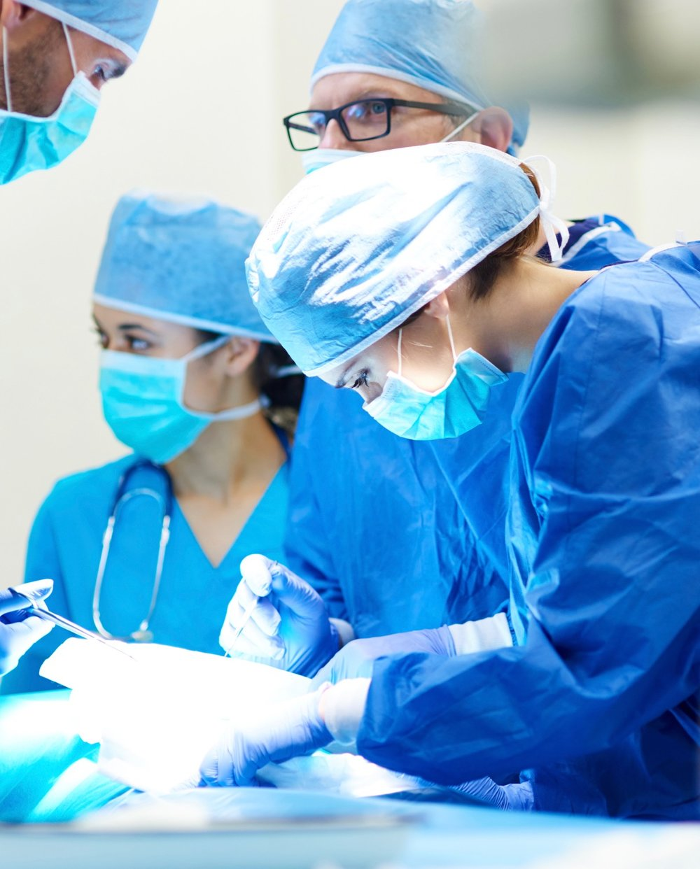 Close up of surgery team operating.jpg