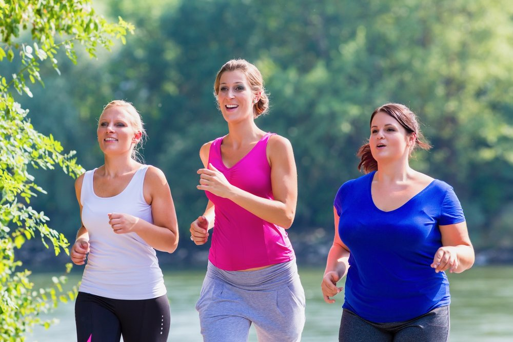 Group of women running at lakeside jogging.jpg