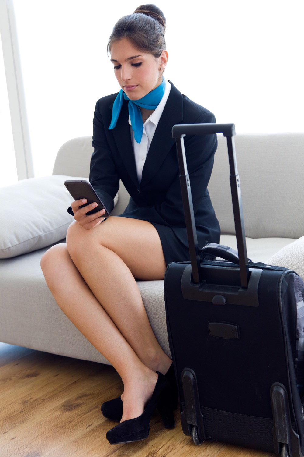 Beautiful hostess in airport with mobile phone..jpg