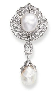 Designed as an openwork rose, single and old mine-cut diamond shield-shaped plaque of foliate motif, set with a baroque pearl, and enhanced by platinum cannetille work, suspending a baroque pearl, with a rose and old mine-cut diamond foliate cap, by similarly-set links, mounted in platinum, circa 1910. Signed B.S.&F. for Black, Starr & Frost
