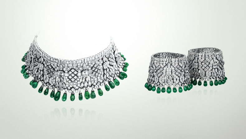 The Manchette Bracelets, created by Van Cleef & Arpels for Daisy Fellowes and manufactured by  Frères Rubel , circa 1928. The stunning choker necklace, made out of emerald beads and diamonds, can be separated and worn as two separate cuffs.   Image courtesy of jewelsdujour.com