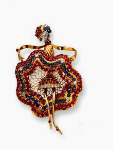 A famous dancer who performed during the war, her pose captured into this brooch set with diamonds, sapphires, rubies and yellow gold, and signed John Rubel, 1943.