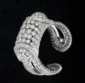 The Cambodian style bracelet, made of platinum, with brilliant cut diamonds and baguettes, made by  Frères Rubel workshop in 1938. it has a heavy aspect but conceals a mechanical system and springs in order to be opened and placed on the wrist.