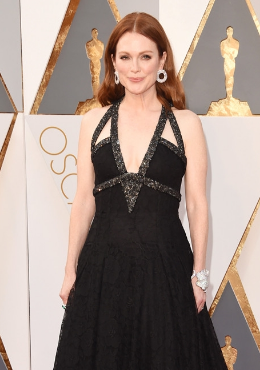 Julianne Moore's bold Chopard circle-motif diamond earrings and floral-motif diamond cuff were head-turners, and complemented her rather simple strappy black Chanel gown well.