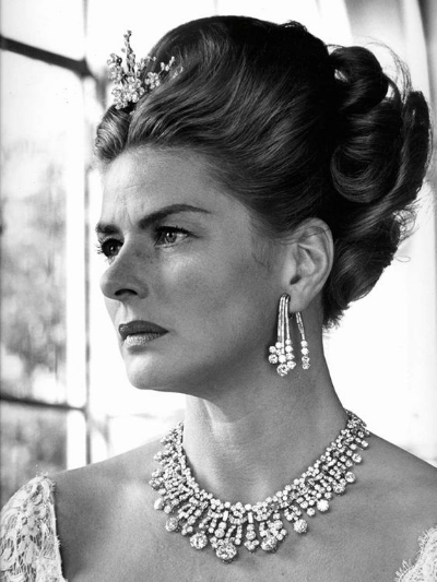 Ingrid Bergman on the set of The Visit in 1964, wearing a Bulgari floral spray brooch in her hair