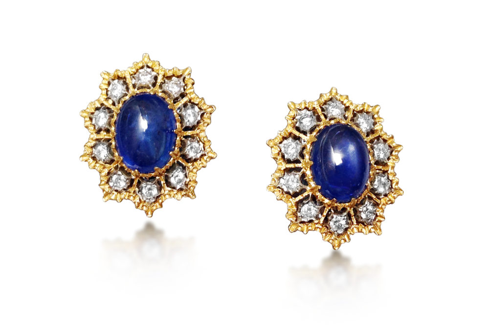 Previously sold at Revival Jewels: A pair of sapphire and diamond earrings. Centrally set with cabochon sapphires approx 8-10 cts in total, the earrings feature lace motif gold open work enhanced by circular-cut diamonds. The pair is mounted in 18K gold, and signed Gianmaria Buccellati, Italy.