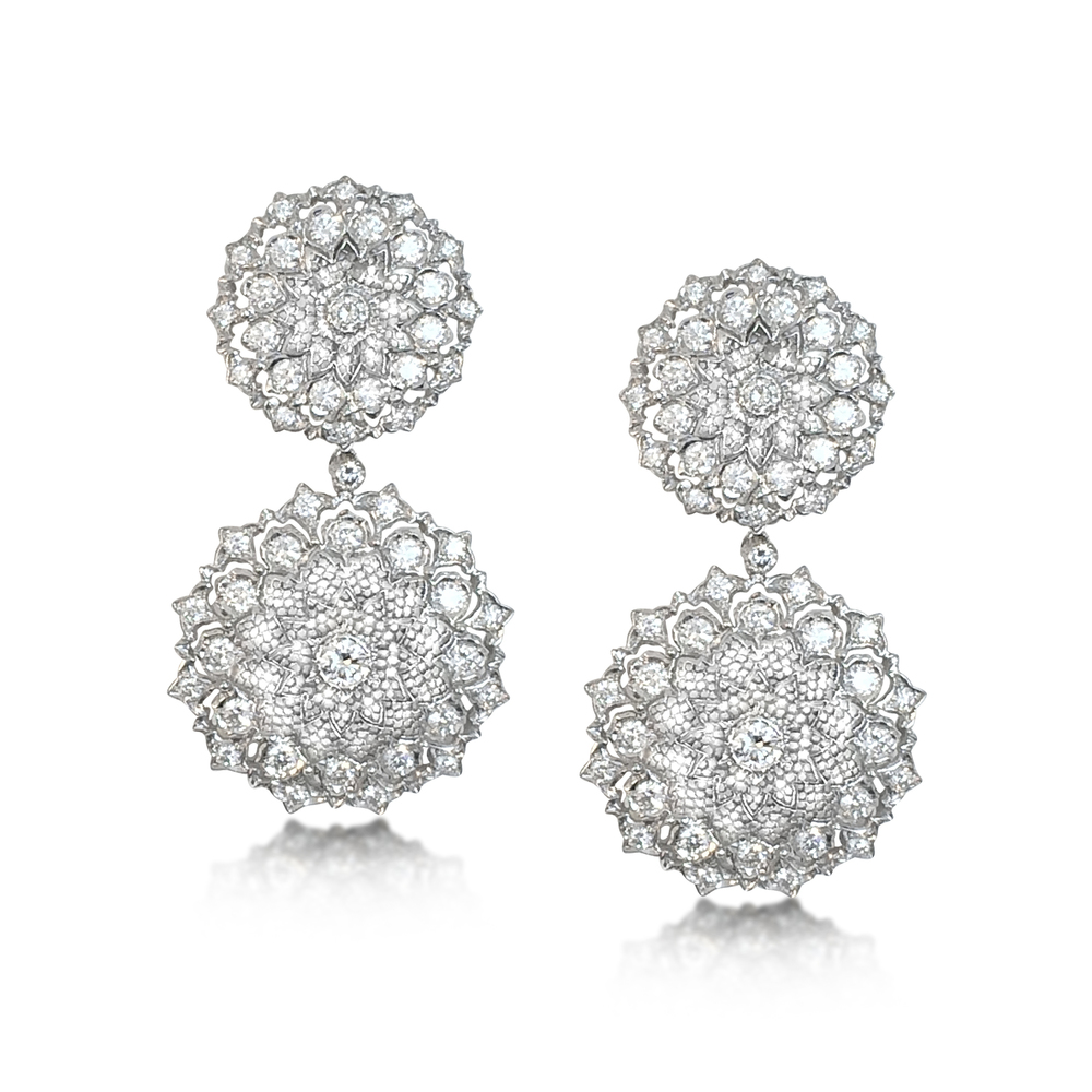 Previously sold at Revival Jewels: A pair of Retro-era diamond and white gold earrings with detachable pendants. Set with 50 diamonds with total weight approximately 12-13 carats.