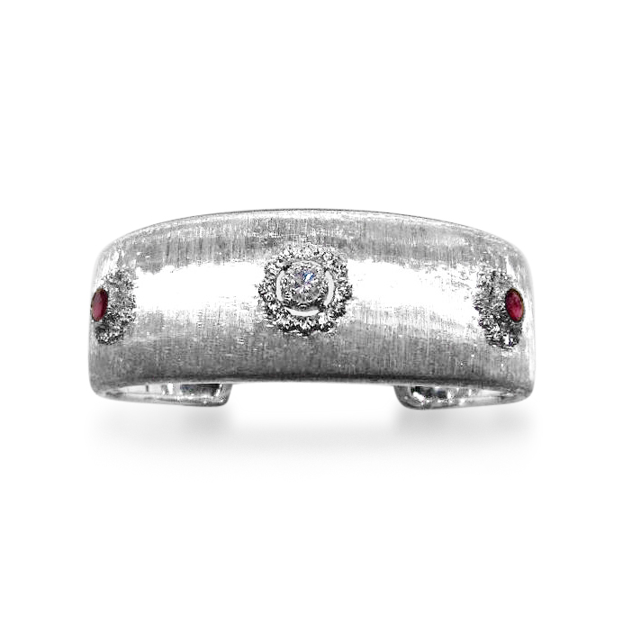 Previously sold at Revival Jewels: A white gold, diamond and ruby cuff bangle.