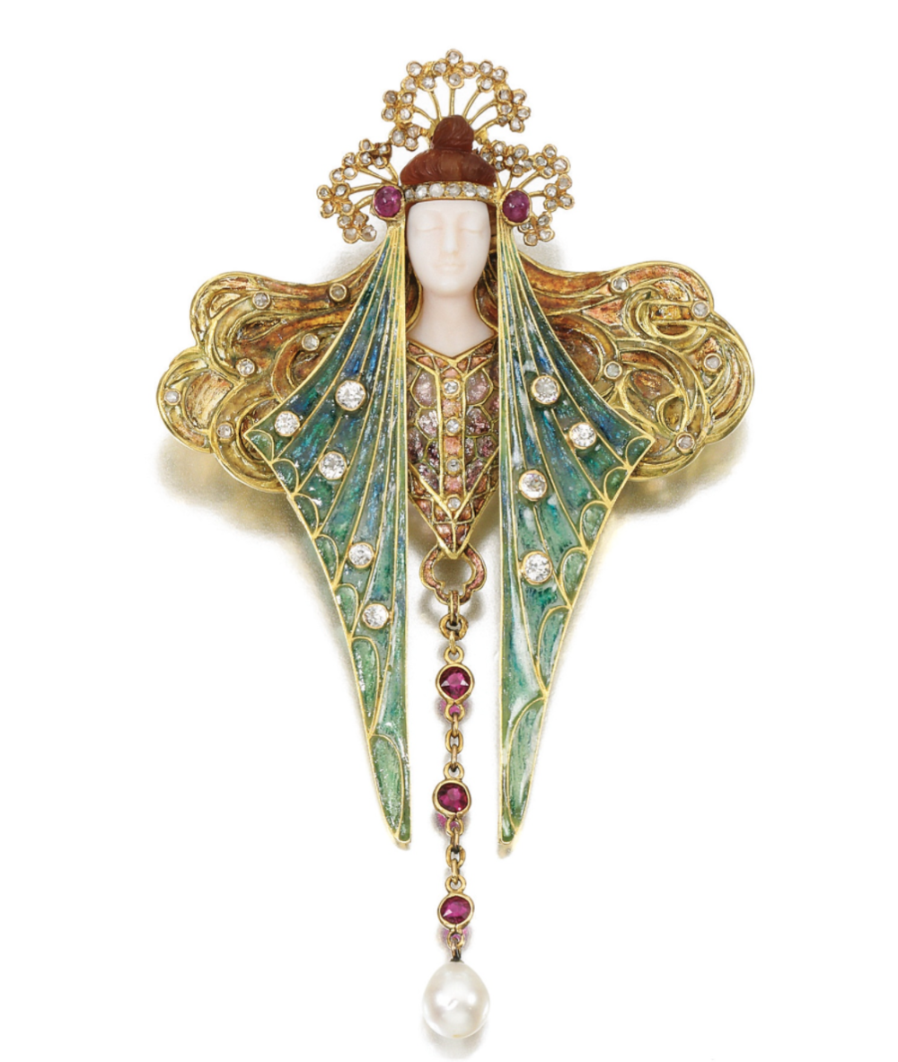 Natural pearl, gem set and diamond brooch/ pendant, Georges Fouquet, Late 19th Century Designed as a lady with flowing hair and headdress, the face and hair composed of carved chalcedony, applied with plique-à-jour enamel and highlighted with cabochon and circular-cut rubies, circular-cut and rose diamonds, suspending a natural pearl, pendant loop, signed G. Fouquet and numbered, French assay marks, case, Fouquet. Estimate: GBP 12,000 — 15,000 LOT SOLD December 2012 . 97,250 GBP (Hammer Price with Buyer's Premium). Photo courtesy of Sotheby's